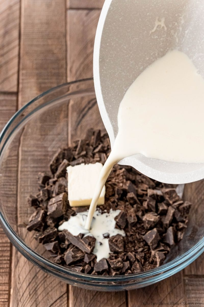Adding the heavy cream into the chocolate.