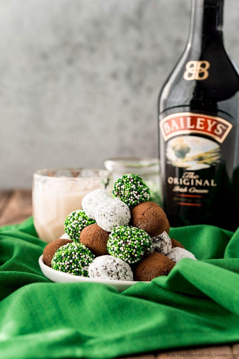Bailey's Irish Cream Truffles with the Irish cream bottle behind it.