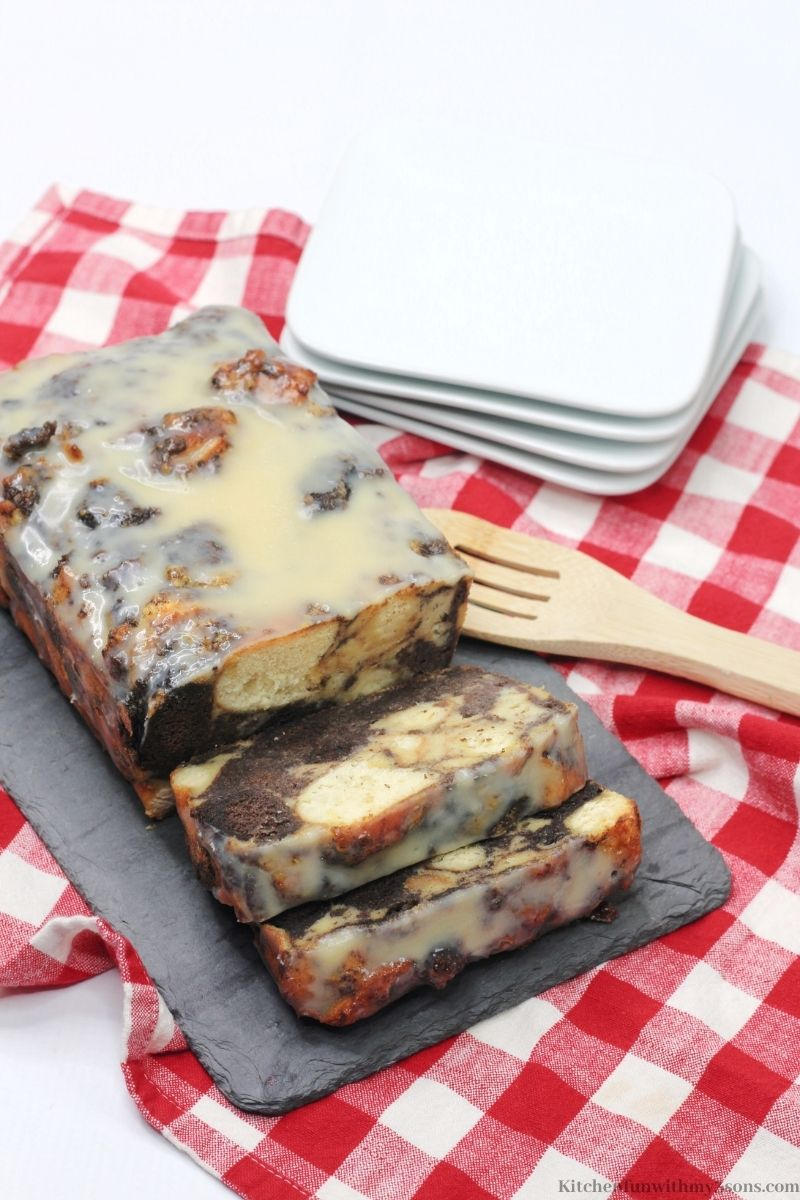 Bourbon Donut Bread Pudding on a white and red checkered cloth.