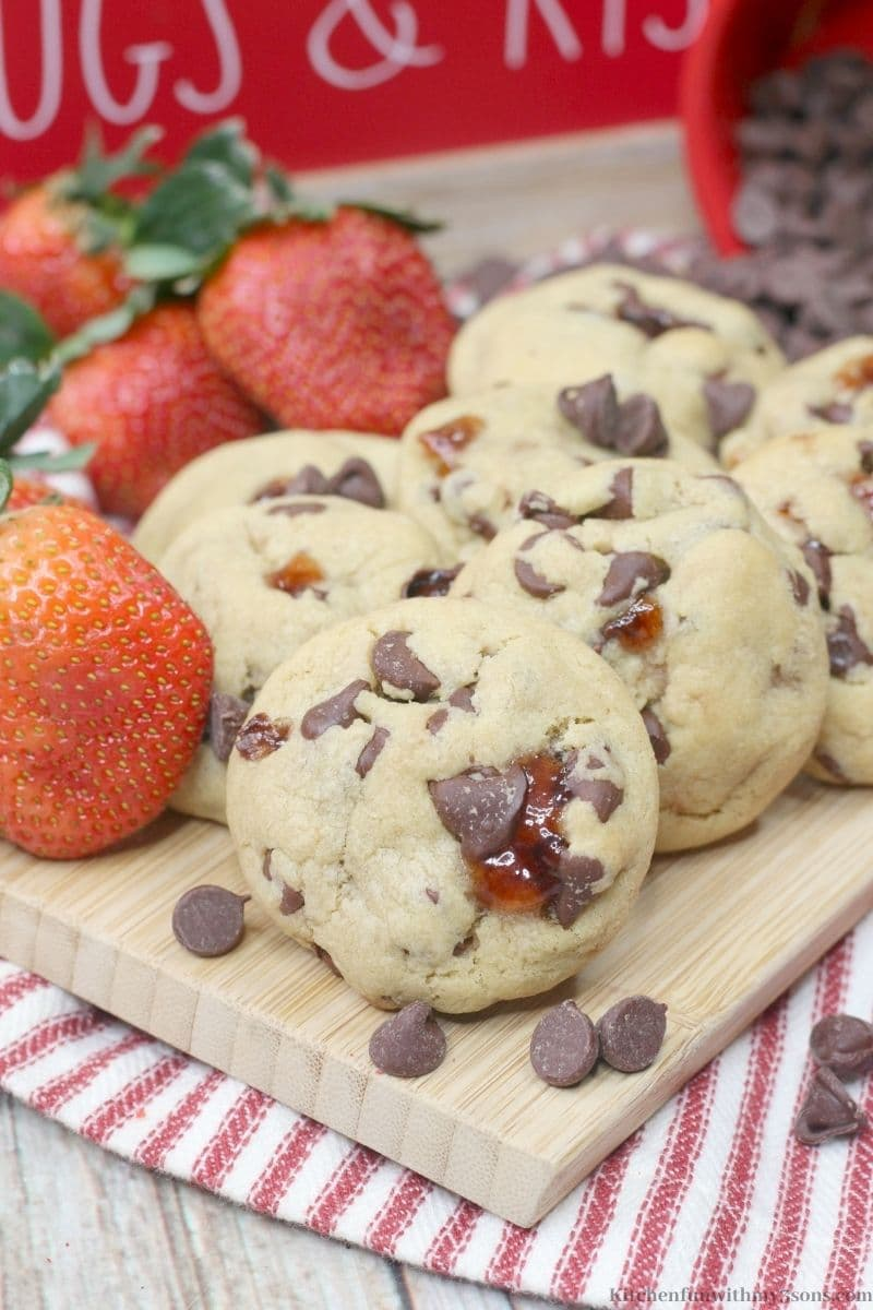 Chocolate Covered Strawberry Cookies with extra strawberries around them.
