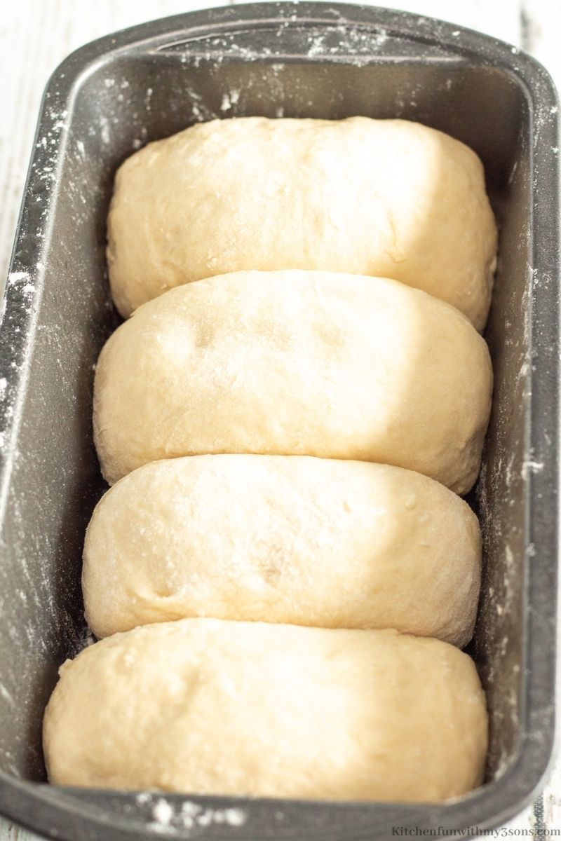 The 4 dough potions rolled into mini loafs in the prepared loaf pan.