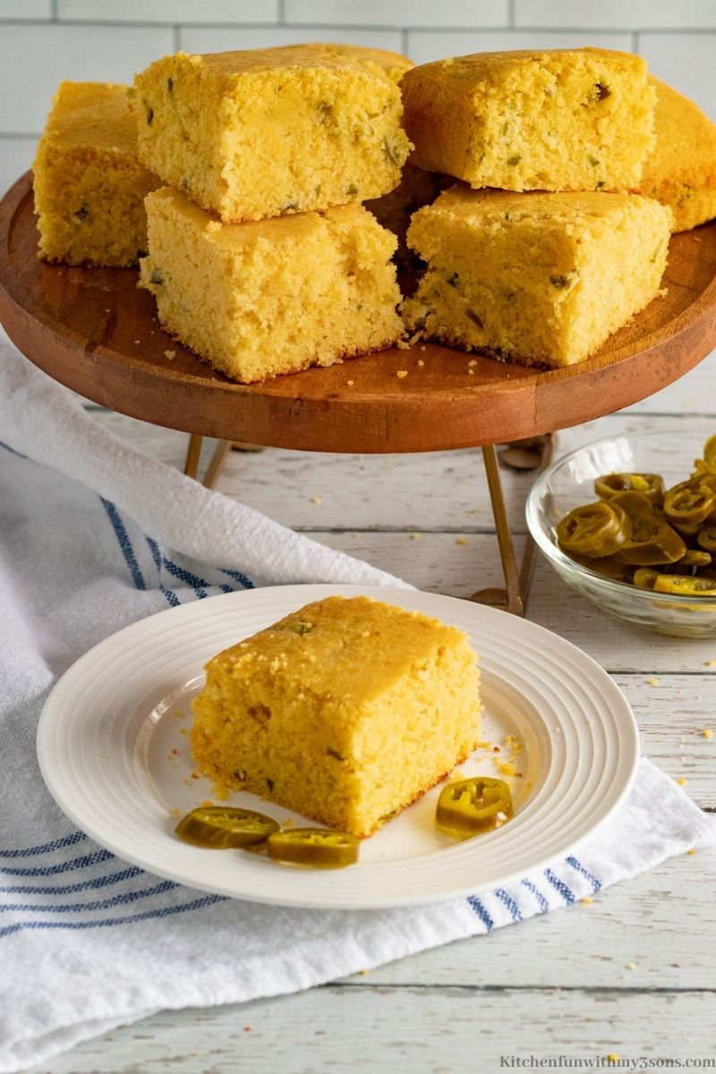 Easy Jalapeno Cornbread on a wooden serving platter.