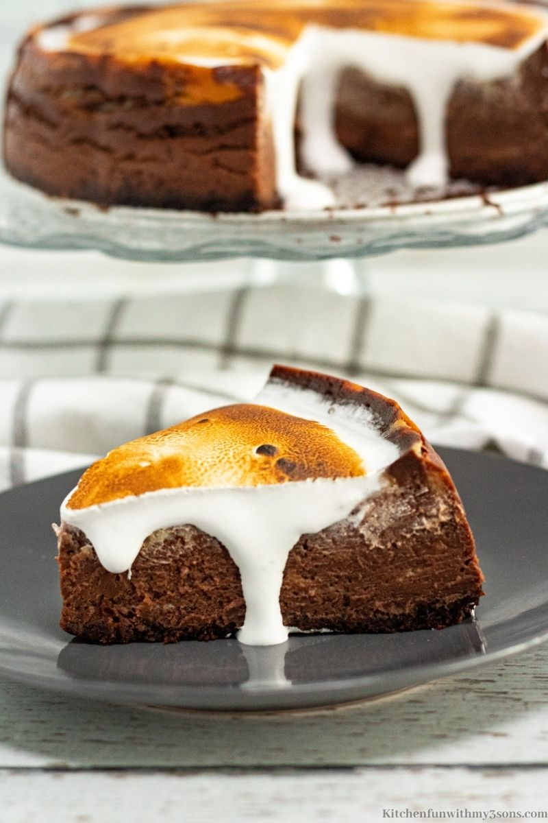 A slice of the Instant Pot Hot Chocolate Cheesecake on a grey serving plate.