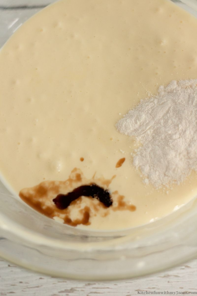 Adding in the other ingredients such as vanilla into the cream cheese filling.