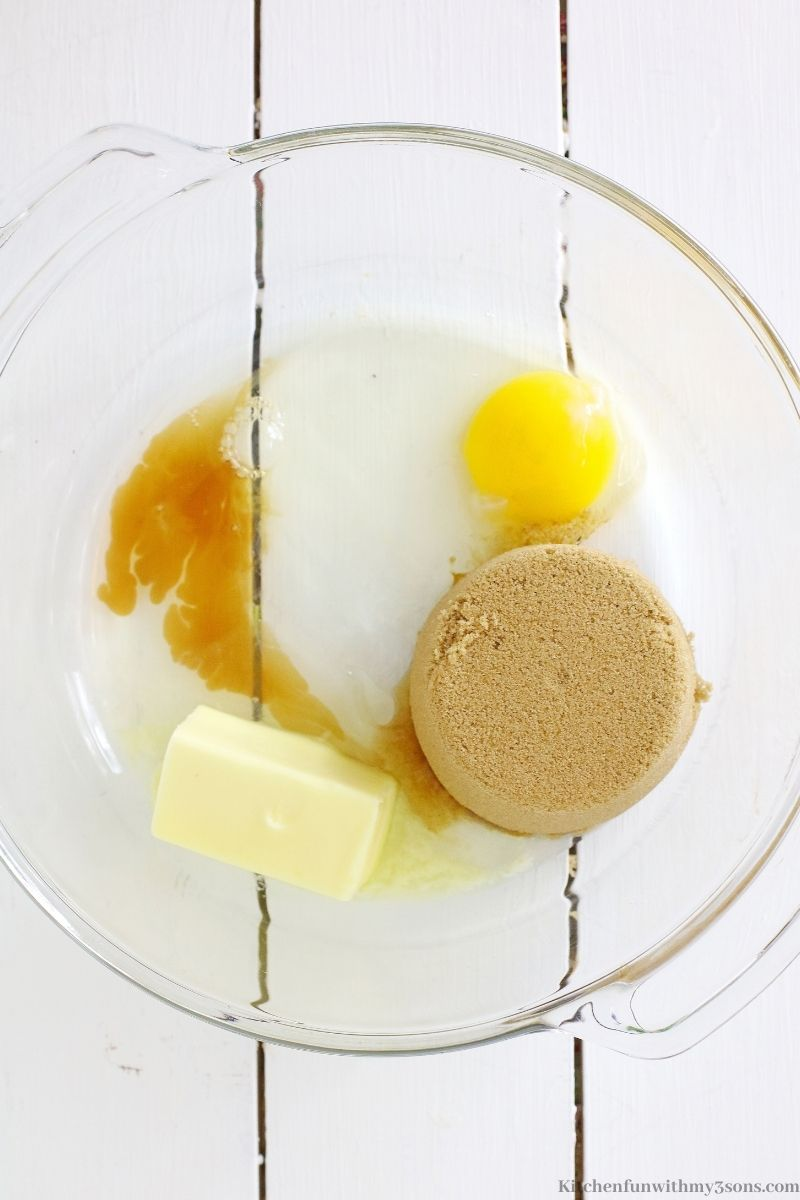 The sugar, butter, egg, and vanilla in a mixing bowl.