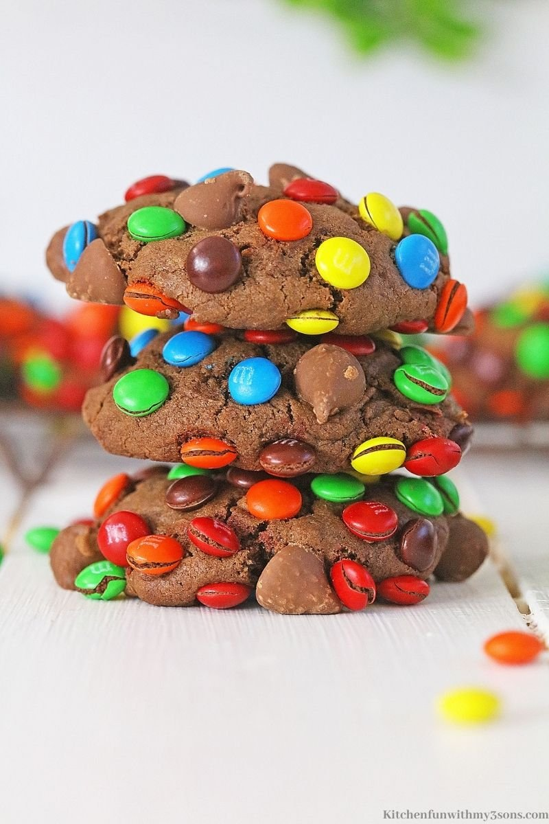 Three of the chocolate cookies stacked on top of each other.