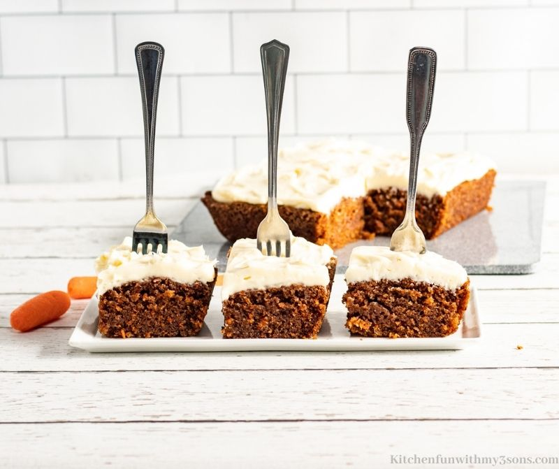 Three pieces of cake with three forks stuck in them.