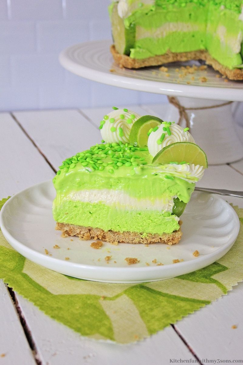 A piece of the no bake key lime cheesecake on a green placemat.