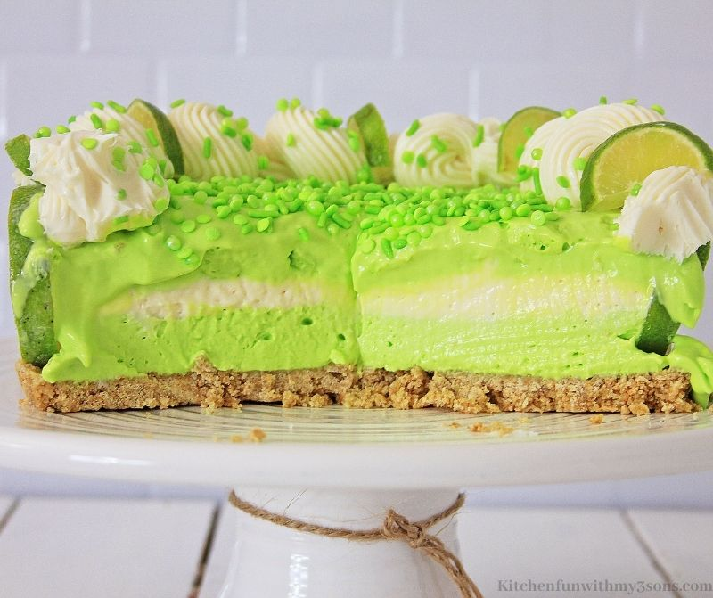 No-Bake Key Lime Cheesecake on a standing serving platter.