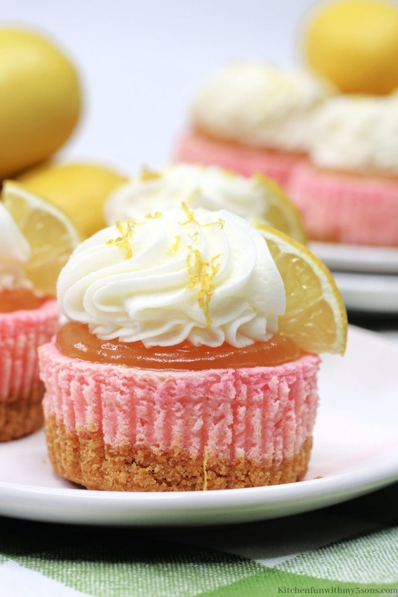 Pink Lemonade Mini Cheesecake topped with whipped cream.