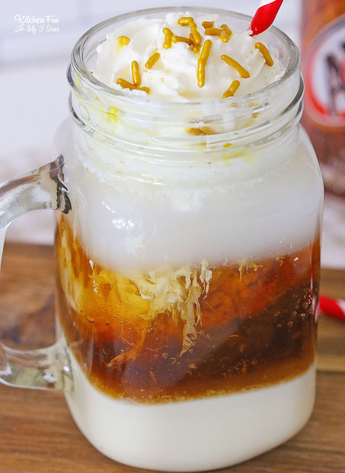 A Root Beer Float Cocktail is a fun twist on a classic treat. This drink has the cool and creamy taste of a root beer float with a kick of vodka and splash of rum.