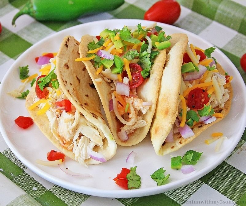 Sweet Chili Lime Instant Pot Chicken Tacos on a serving plate.