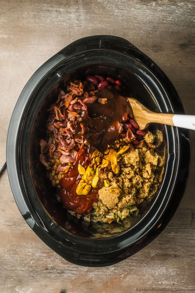 Combining the other ingredients and spices into the crockpot.