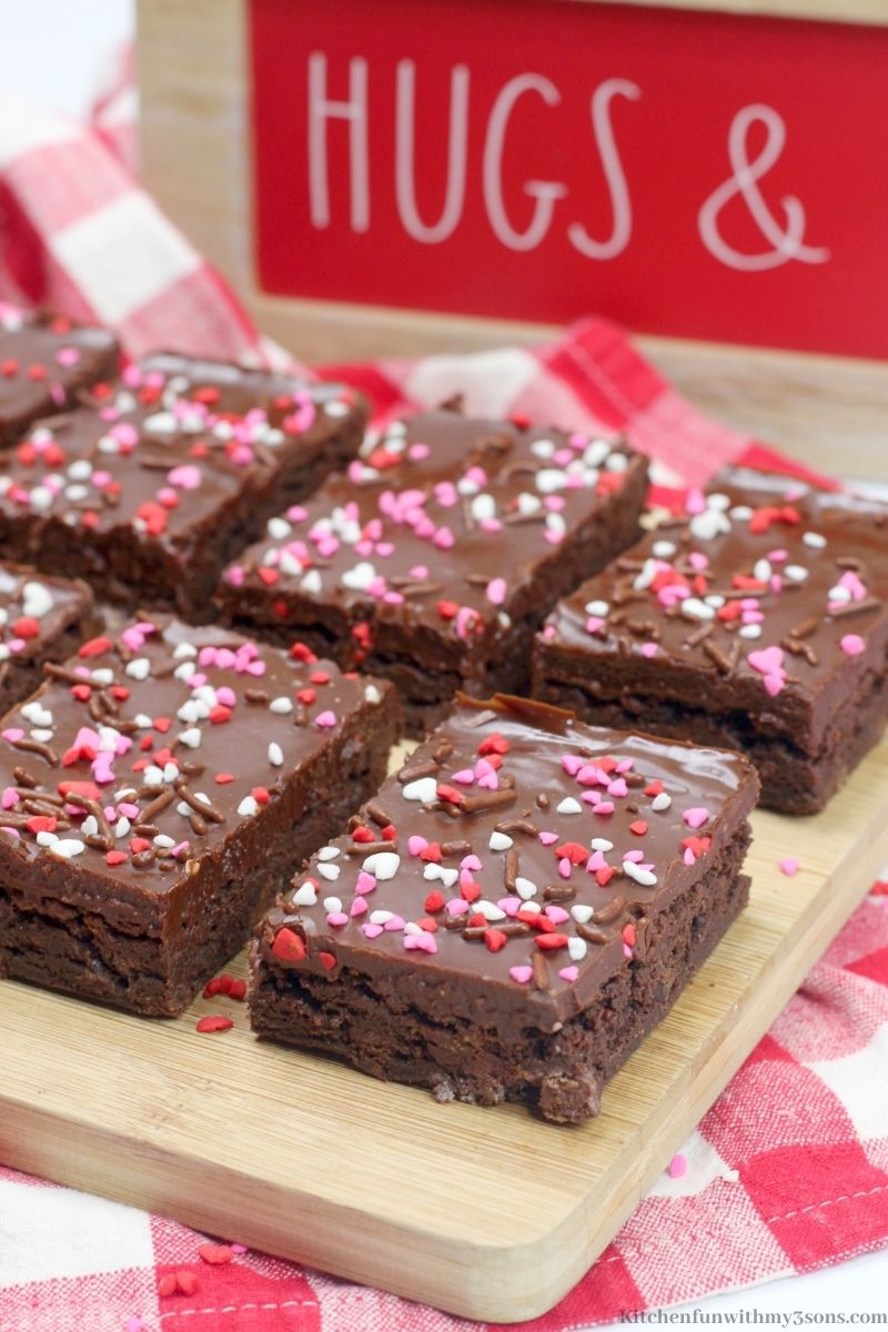 Valentine's Day Brownies on a wooden cutting board.