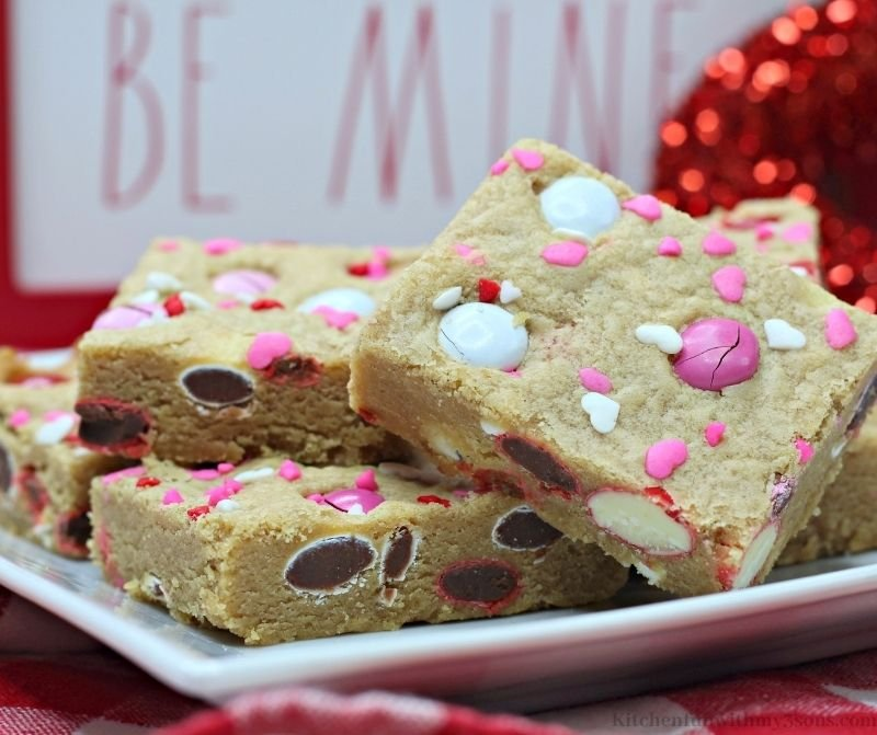 Valentine's Day Peanut Butter Cookie Bars on a white serving platter.