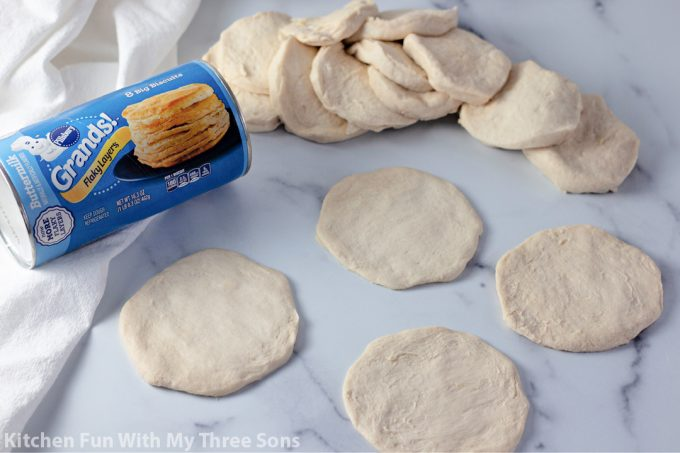 Grands biscuit dough separated to make pizza crusts.