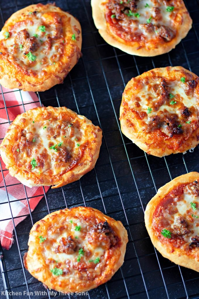 Easy Air Fryer Pizzas on a wire cooling rack.