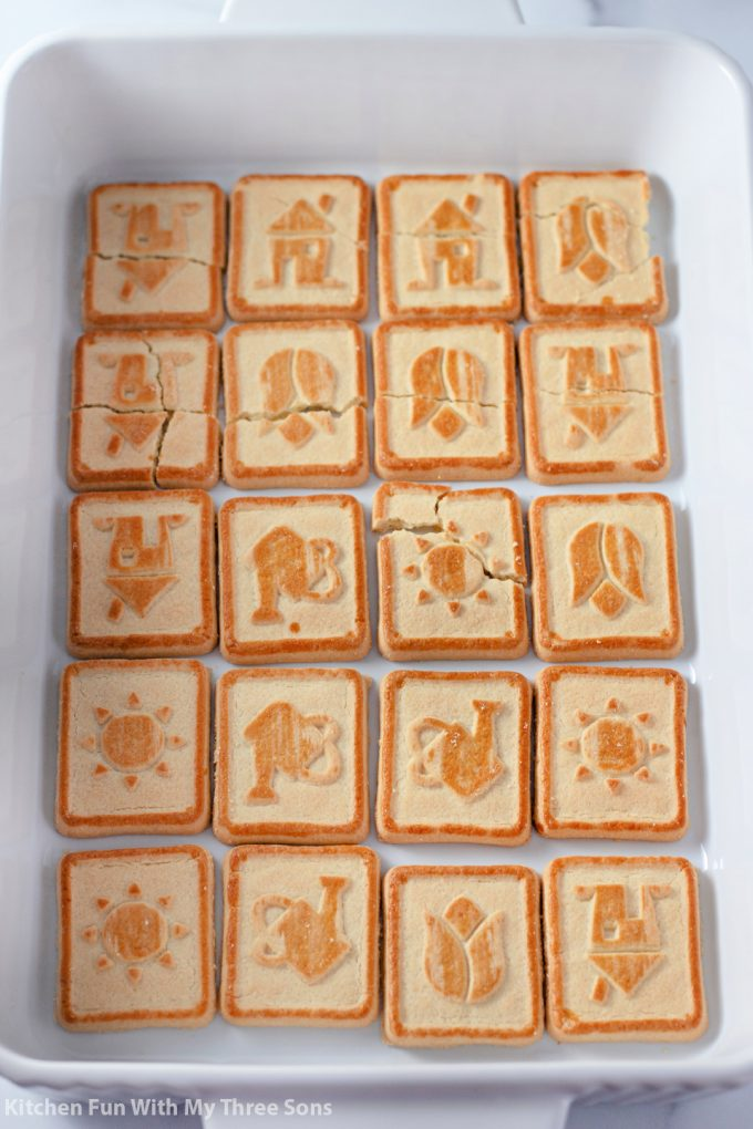 first layer of Chessmen cookies in a white dish.