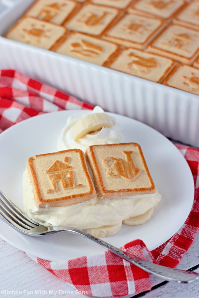 slice of The Best Banana Pudding Recipe on a white plate.