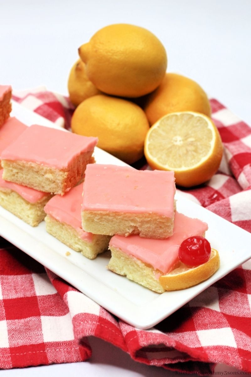 Cherry Lemonade Bars on a checkered white and red cloth.