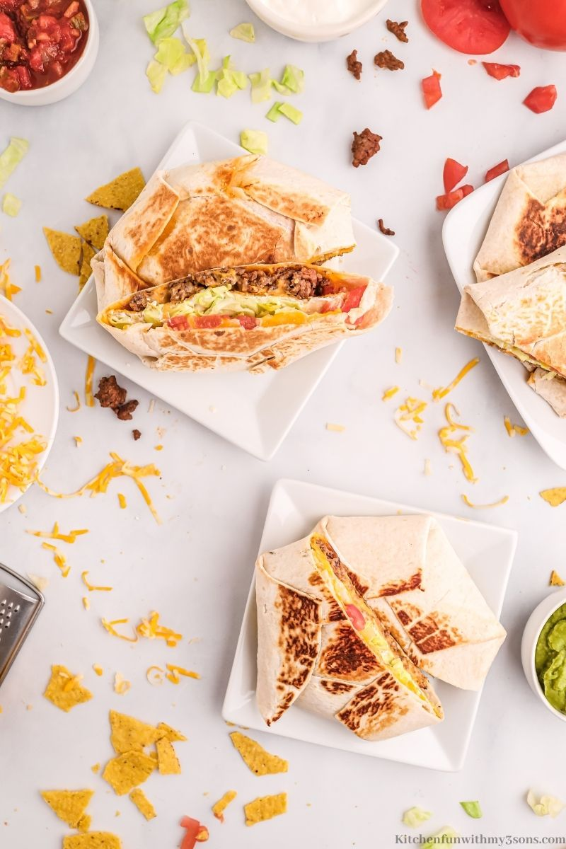 Crunch wraps on two separate serving plates.