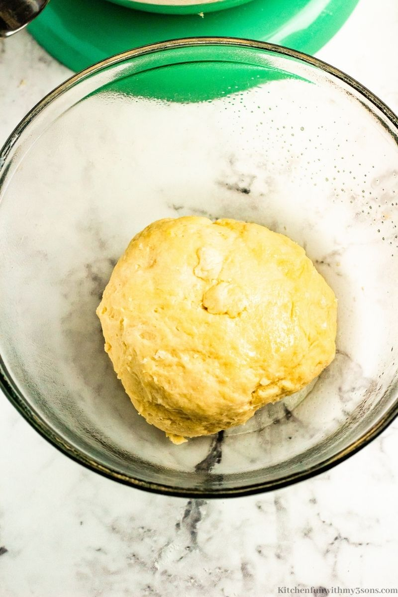 The dough in a grease bowl.