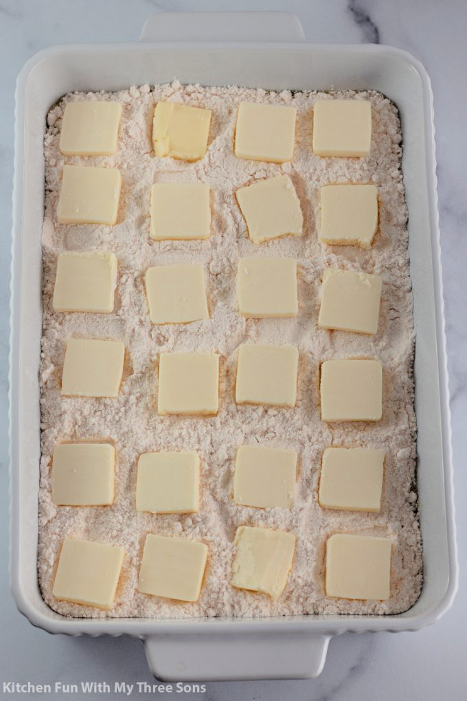 squares of butter on top of the cake mix.