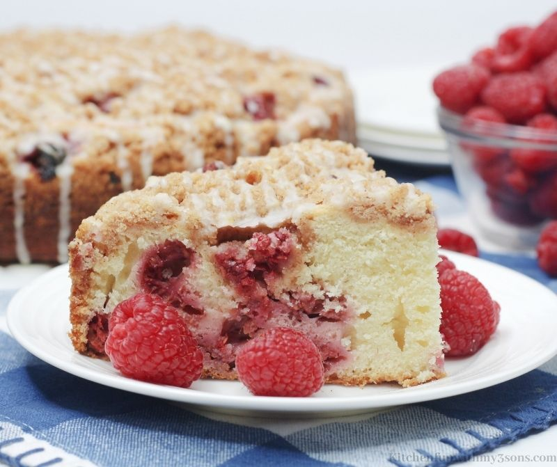 A piece of the Raspberry Crumble Cake on a white serving plate.