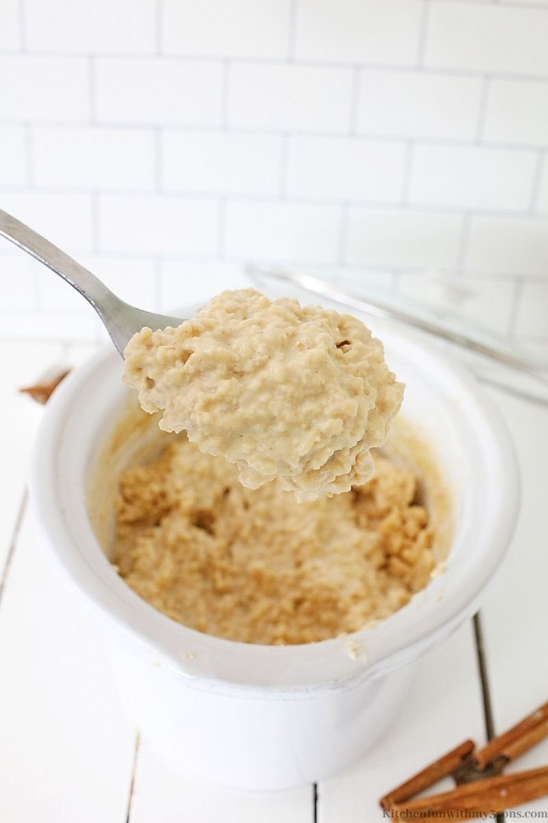 A spoon showing the thick consistency of the finished rice.
