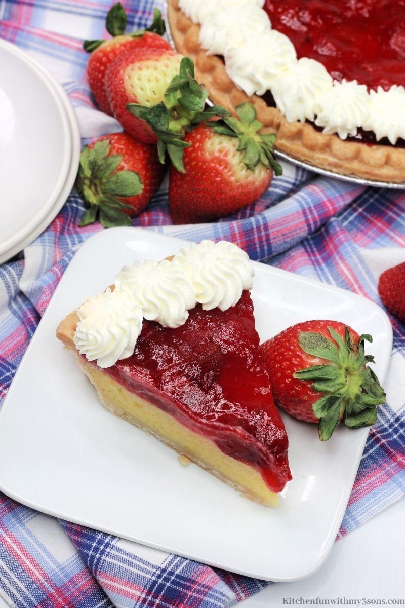 Strawberry Lemon Easy Cheese Pie with extra strawberries around it.