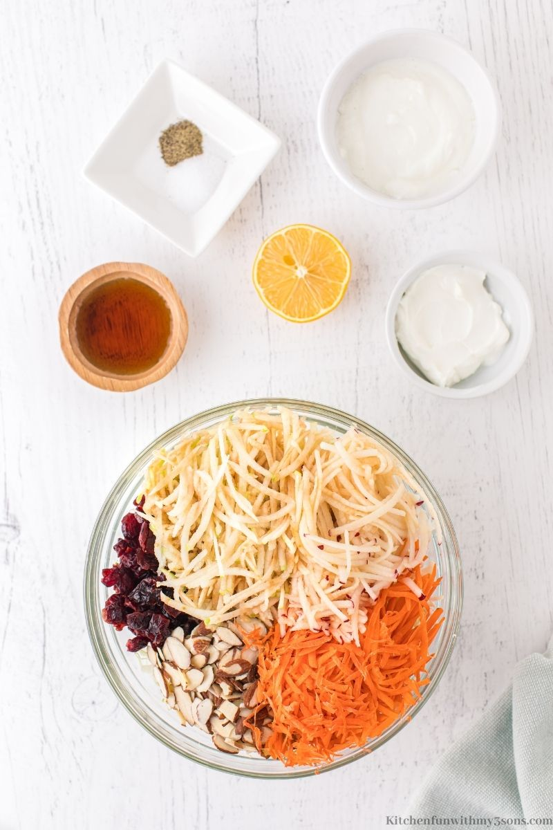 All of the shredded vegetables, cranberries, and almonds in a bowl.