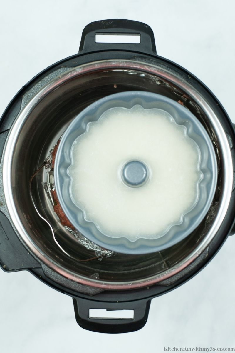 The rice and water in a small Bundt pan in the Instant Pot.
