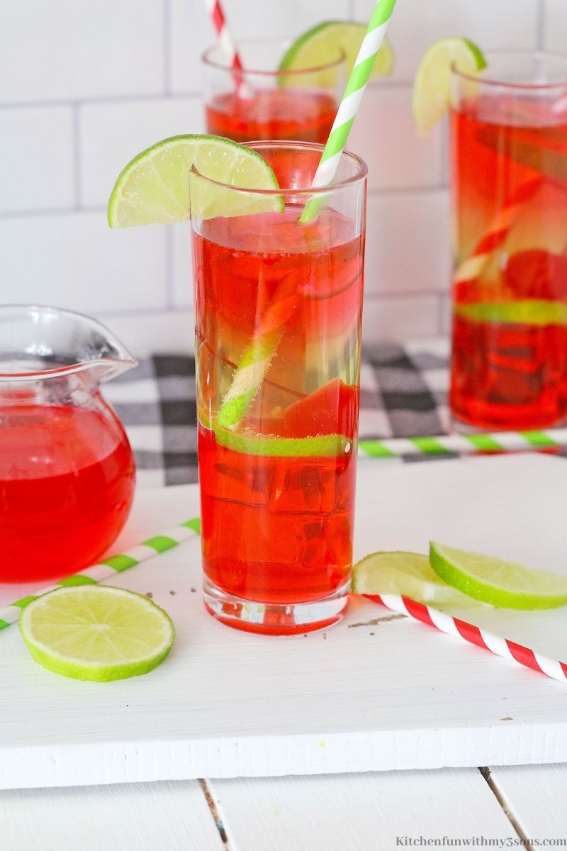 Vodka Cherry Limeade Cocktail garnished with a lime wedge.