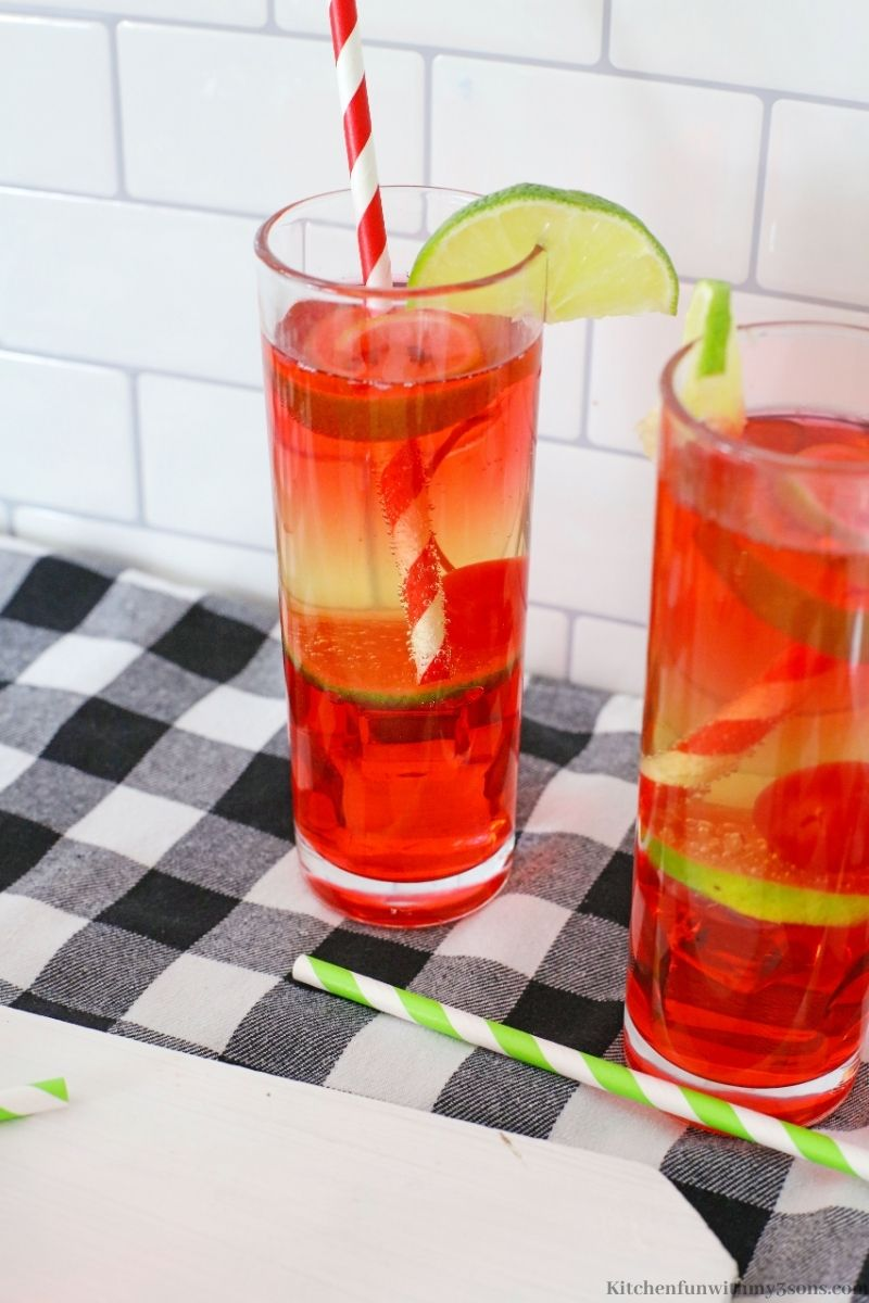 Vodka Cherry Limeade Cocktail on a checkered black and white cloth.