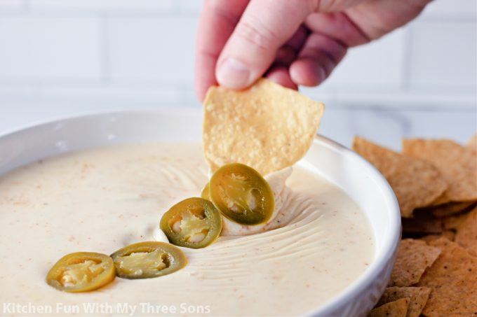 jalapenos on top of queso dip
