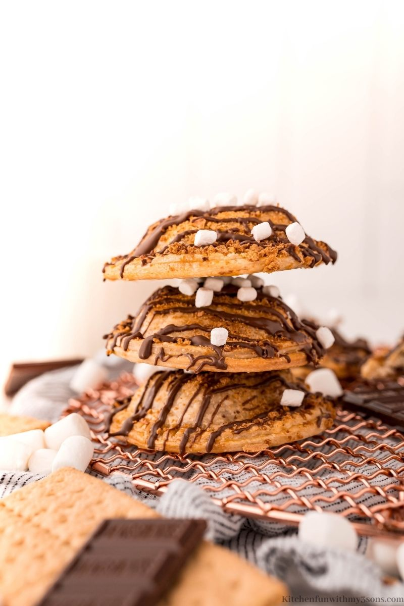 Three of the Air Fryer Smores hand pies topped on top of each other.