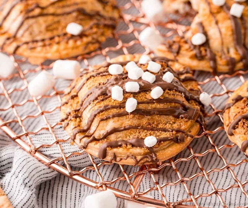 The smores hand pies on a wire rack.