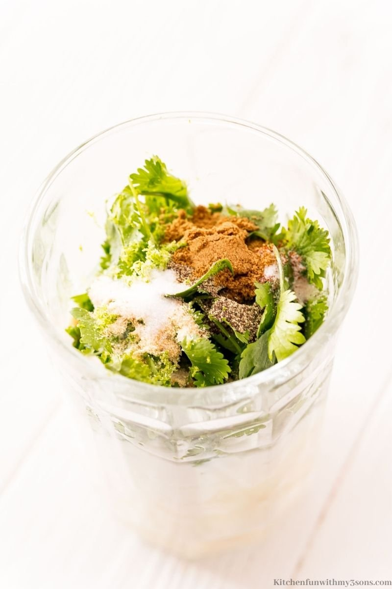 All the dressing ingredients in a large glass.