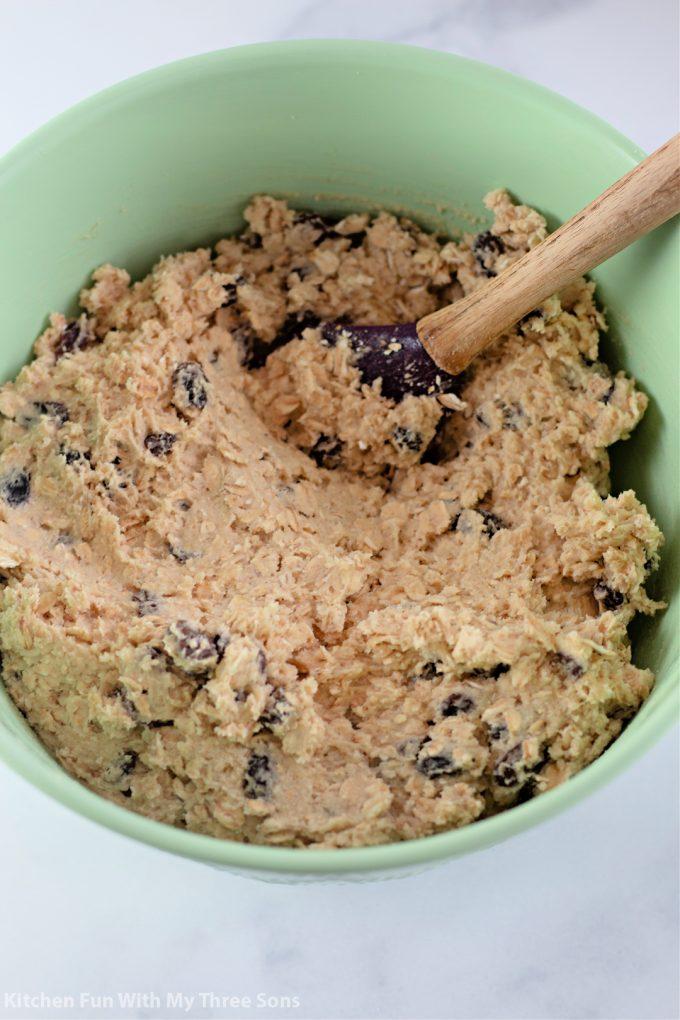 prepared cookie dough in a mint green bowl.