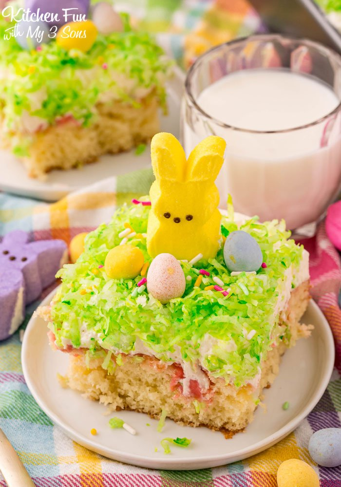 This Peeps Cake is a deliciously moist poke cake recipe full of flavor. Perfect for Easter, this is a dessert that everyone loves.