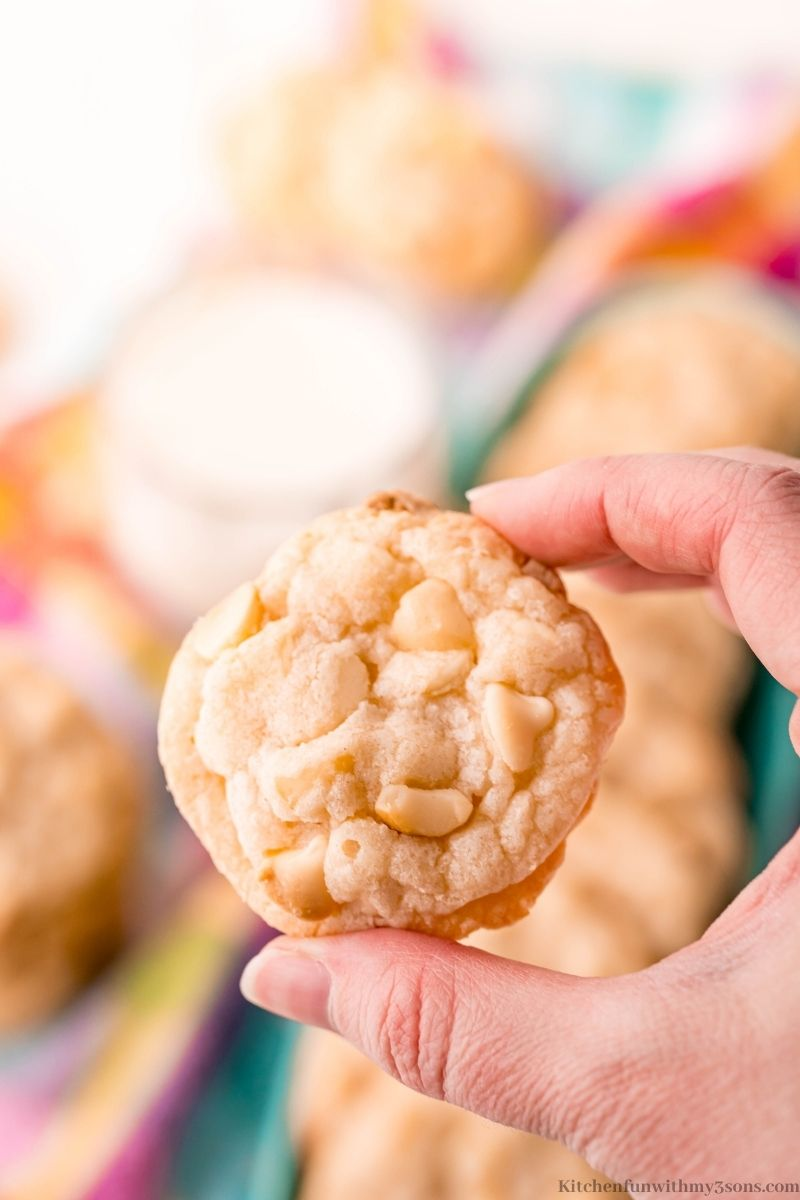 A hand lifting up one of the cookies.