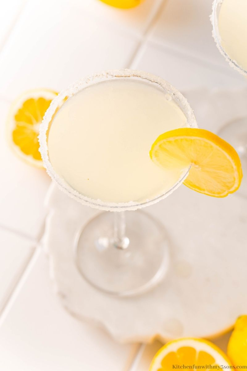 A downward view of one of the martini glasses with a lemon wedge.