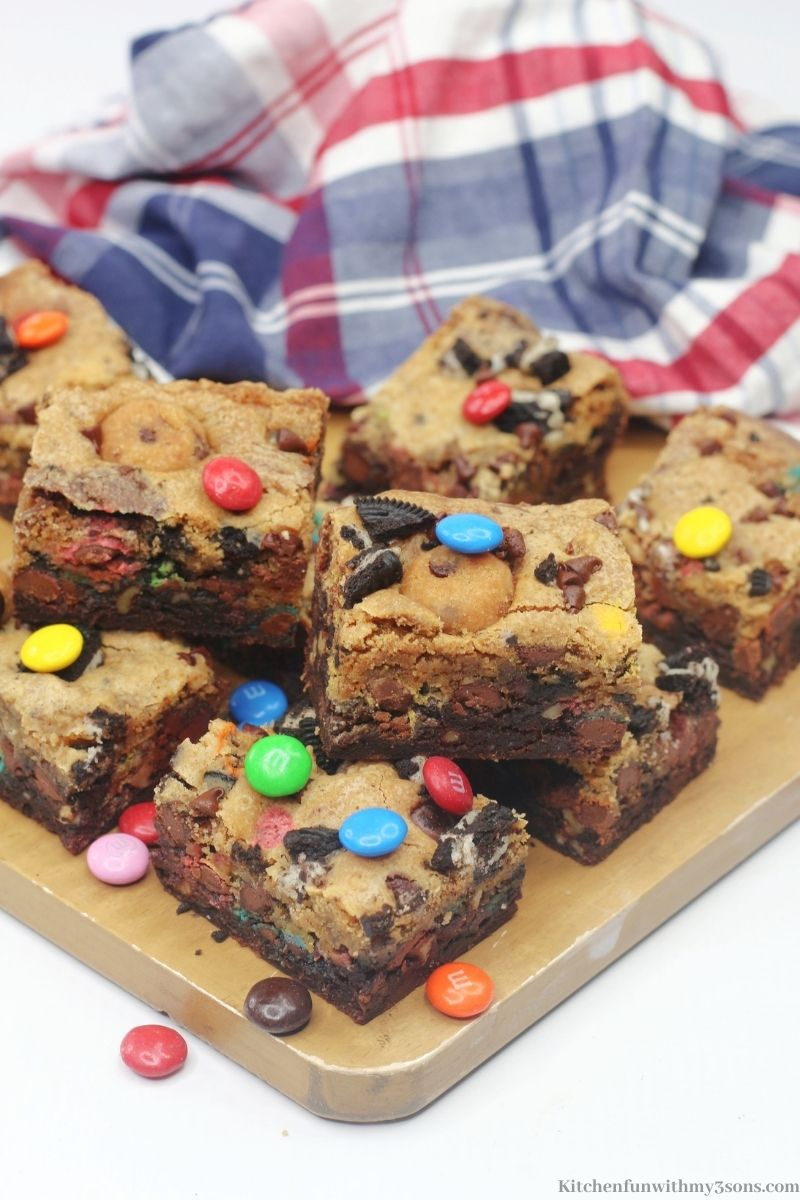 Brookie Bars with a multi-colored cloth behind them.