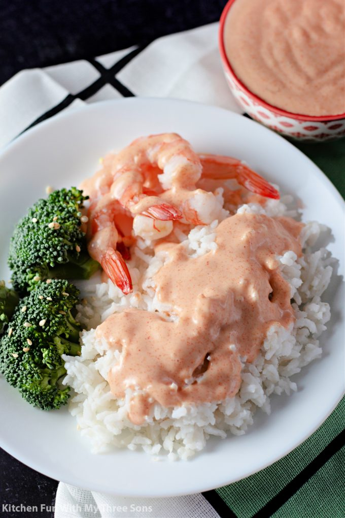 Homemade Yum Yum Sauce over rice and shrimp.
