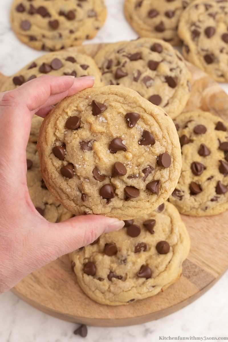 A hand holding up one of the cookies.