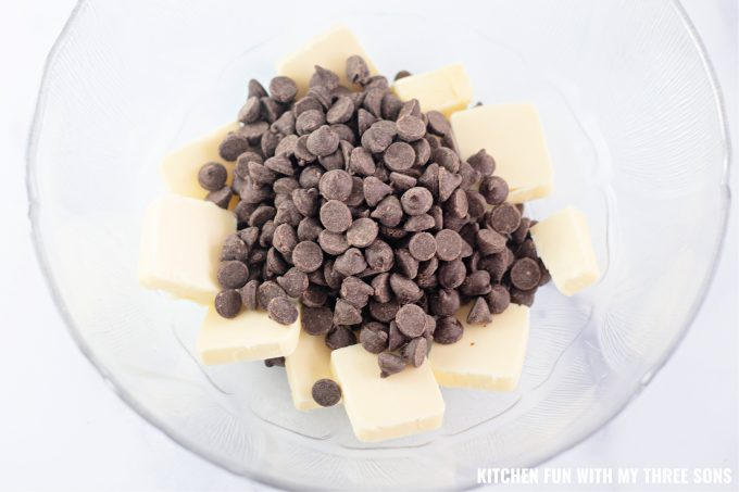 chocolate chips and butter in a clear bowl.