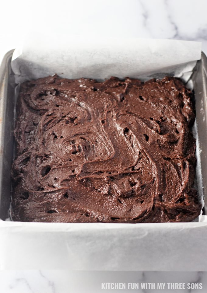 brownie batter in an 8x8 inch baking pan.