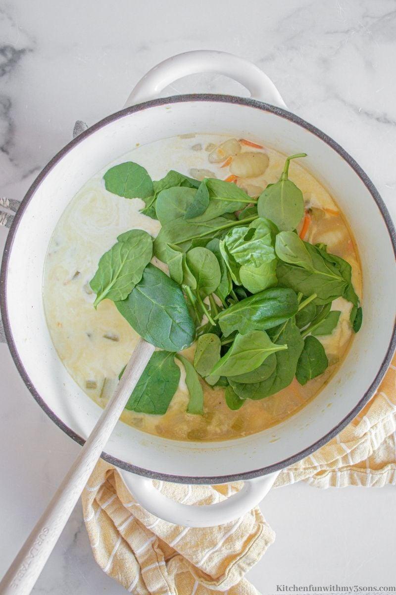 Adding the spinach into the recipe.
