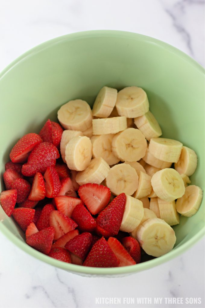 strawberries and bananas in a mixing bowl.