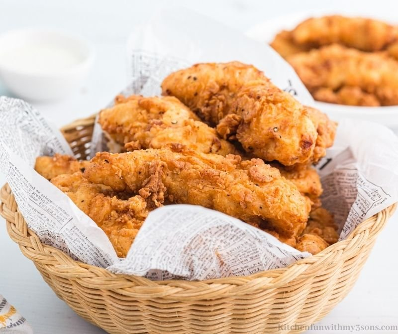 Tenders in a bowl with tissue paper.